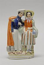 STAFFORDSHIRE POTTERY FIGURE GROUP A young woman and soldier. Height 6.8