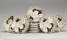 SET OT TEN FRENCH PORCELAIN OYSTER PLATES In brown and gold with oysters laid out on a net decoration. Diameter 8.75