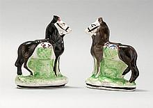 PAIR OF STAFFORDSHIRE HORSE FIGURES Each in brown and white with a basket of flowers at their sides. Heights 7