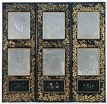 PAPIER MÂCHÉ THREE-PANEL DRESSING SCREEN Under a black finish with gilt floral borders. Each panel with two inset mirrors. Each pane...