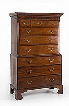 ANTIQUE ENGLISH CHEST-ON-CHEST In mahogany. Upper case features a modified dental molding to cornice. Three drawers over three gradu...
