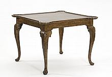REPRODUCTION ENGLISH GAME TABLE In mottled brown paint. With cabriole legs, shell-carved knees, and duck feet. Height 30