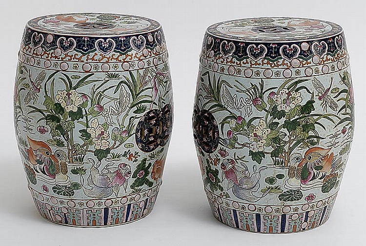 PAIR OF CHINESE PORCELAIN GARDEN SEATS in drum form with carp and lotus design. Height 17½