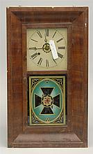 NEW HAVEN CLOCK CO. MAHOGANY-VENEERED OGEE SHELF CLOCK (New Haven, Connecticut, 19th Century) Thirty-hour movement. Enameled dial. R...