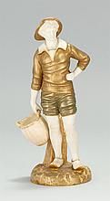 EARLY 20TH CENTURY ROYAL WORCESTER IVORYWARE FIGURE. In the form of a standing fisherman holding a wicker basket. Height 8.25