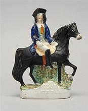 MID-19TH CENTURY STAFFORDSHIRE POTTERY FIGURE OF