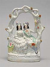 19TH CENTURY STAFFORDSHIRE POTTERY TWO-FIGURE GROUP. A man holding a bird and a woman sitting beneath a foliate arbor. With polychro...