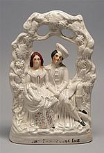 LATE 19TH CENTURY STAFFORDSHIRE POTTERY FIGURAL GROUP depicting a man and woman seated beneath a reticulated arbor. Indistinctly tit...
