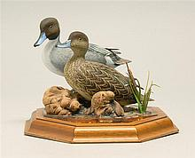 MINIATURE PAIR OF PINTAILS by Larry Tawes Jr. of Hebron, Maryland. Mounted in standing form on a marsh vignette on a walnut base. Dr...
