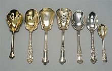 SEVEN GORHAM STERLING SILVER FLATWARE SERVING PIECES (Late 19th/Early 20th Century). Various monograms. 1) Polychrome-enameled and g...