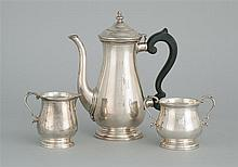 THREE-PIECE CARTIER STERLING SILVER TEA SET In an 18th Century form. Monogrammed. Consists of a teapot with ebonized wooden handle,...