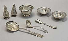 EIGHT PIECES OF STERLING SILVER FLATWARE AND HOLLOWWARE By various makers. Includes a berry spoon by S. Kirk & Son in the