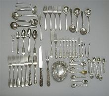FIFTY-TWO PIECES OF STERLING SILVER FLATWARE By various makers. Includes two-piece repoussé steak carving set, dinner forks, luncheo...