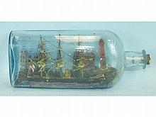 A model of the three-masted steam and sail ship 'Lion', in port at New Somerset, contained in glass