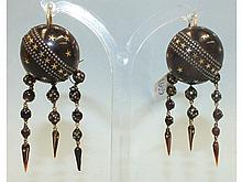 A pair of Victorian piqué earrings, each of domed form with a diagonal line of stars between a desig