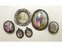 Five graduated oval porcelain plaques painted with figures, with cut steel borders, largest 34mm, sm