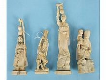 A group of four Japanese ivory figures of men carrying gourds, basket and a child, largest 20.5cm, (