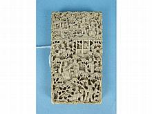 A small 19th century Chinese ivory card case, finely-carved with figures and garden scenes, 4.7 x 8.