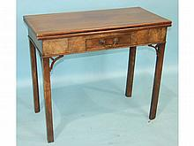 A George III mahogany tea table, the fold-over rectangular top above a small frieze drawer, on squar