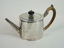 A George II cylinder-shaped coffee pot engraved with two crests marked beneath, London 1757, 13cm hi