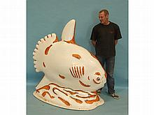 A fibreglass model of a sunfish decorated in black and orange by Reg Ward '14, 173cm long, 160cm hig