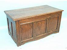 A 17th century panelled oak coffer with hinged lid, 124cm x 61cm, 61cm high.
