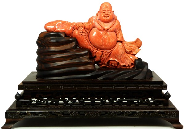 FINE CHINESE CARVED RED CORAL SEATED BUDDHA FIGURE