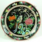 CHINESE ENAMELED FAMILLE NOIR PORCELAIN CHARGER