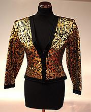 SAINT LAURENT rive gauche - veste courte à motifs noirs gauffrés sur fond d'or,