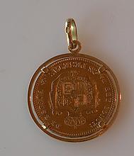 PIÈCE de 25 pesetas en or à l'effigie d'Alfonso XII datée 1880 montée en pendent