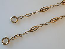 CHAINE de montre en or jaune maille oblongue et rondes alternées. Poids 24 g