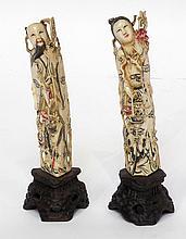 COUPLE de sujets en ivoire sculpté.