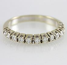 Damenring WG 14 K mit 12 Diamanten zus. ca. 0,6 ct getönt/pique.