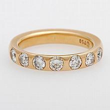 Memoire- Ring besetzt mit sieben Diam.- Brillanten zus. ca. 0,97 ct, W/ SI- PIQUE.