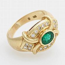 Damenring mit einem ovalfacettierten Smaragd und 18 Diam.-Brill. zus. ca. 0,4ct, Feines Weiß-Weiß/ VS-SI.