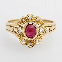 Damenring mit einem Rubin-Cabochon, Diamanten zus. ca. 0,15ct, Weiß/ VS-SI.
