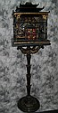 Antique Chinese black and red lacquer and parcel-gilt birdcage on stand.