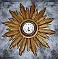 Louis XVI style gilt-wood sunburst clock.