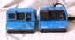 L11 LOT OF 2 VINTAGE 198Os BLUE IMPULSE POLAROID CAMERAS