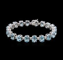 14KT White Gold 27.80ctw Topaz and Diamond Bracelet