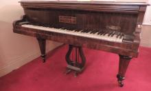 A Collard and Collard Boudoir Grand Piano, in a figured rosewood case, on t