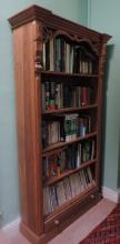 A pair of tall Open Pine Bookcases, with inverted breakfront cornice, carve