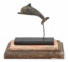 Rare Ancient Greek bronze model of a dolphin, sicily, 5th century b.c., Black and verdigris partina with well-cast beak, dorsal fin and