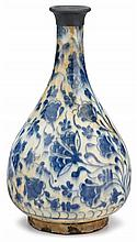 Safavid blue and white bottle vase, iran, mid to late 16th century, Pear-form decorated with floral sprays in the round, the rim with m