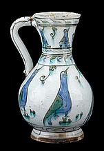 Iznik pottery jug, ottoman turkey, circa 1600-1650, Pear-form decorated to the neck and body with figures of birds in cobalt blue, gree