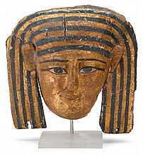 Egyptian polychrome and giltwood mummy mask, ptolemaic to early roman period, circa 332 b.c.-641 a.d., On custom acrylic stand.