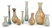 Collection of nine Roman glass vessels, circa 3rd-4th century a.d., Of various forms and sizes.