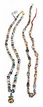 Four sets of ancient Egyptian semi-precious stone and glass necklace beads, , Comprising a string of approximately sixty garnet beads;