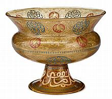 Brocard Mamluk style gilt and enameled amber glass footed bowl, paris, circa 1891, The compressed ovoid bowl form with flaring rim and