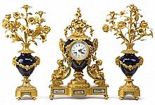 Louis XVI style gilt bronze and cobalt ground porcelain clock garniture, 19th century, japy frères movement, The circular enamel dial w